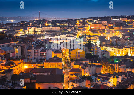 Lisbon city, view at night across the rooftops of the old town Mouraria area towards the center of the city of Lisbon, Portugal. - Stock Photo