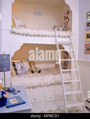 Fitted bunk beds in childrenÕs bedroom - Stock Photo