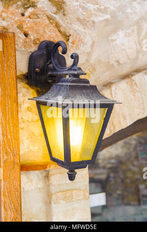 Lamp post of the house in Saint Paul de Vence, medieval town in France - Stock Photo