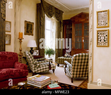 Sitting room with pair of upholstered armchairs in check fabric, - Stock Photo
