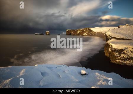 Dyrholaey cape over black sand beach in Iceland