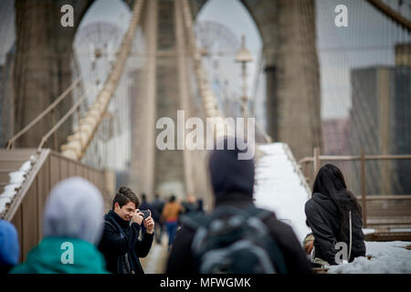 Brooklyn in New York City, No Locks fine notice on Brooklyn Bridge tourist stop to take pictures on the landmark structure - Stock Photo