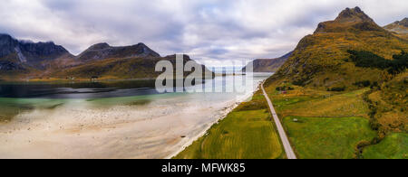 Scenic road along the coastline and mountains on Lofoten islands - Stock Photo