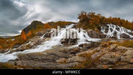 Lofoten waterfall on Moskenesoya, Lofoten, Norway - Stock Photo