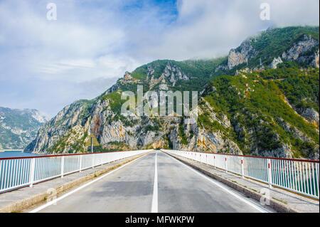 Bridge over the Piva lake, mountains in Montengro - Stock Photo