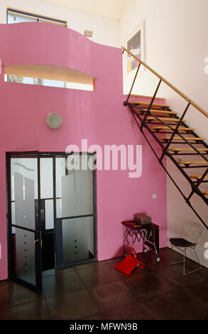 Open plan staircase and hallway with view of kitchen in residential ...