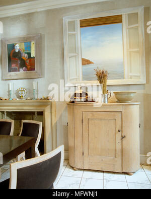 Painting of view above country style cupboard next to fireplace - Stock Photo