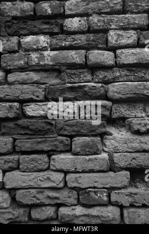 Black and white image of wall damaged by  sea salt erosion, Venice, Italy. - Stock Photo