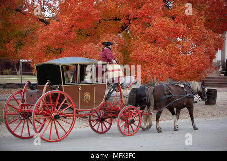Horse drawn restored carriage on Duke of Gloucester street in colonial Williamsburg Virginia - Stock Photo