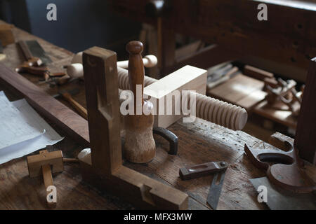 still life of authentic cabinet makers hand tools in his workshop in colonial Williamsburg Virginia - Stock Photo