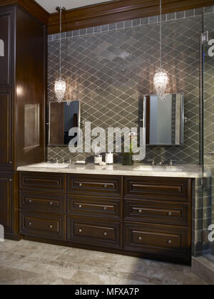 Pair of washbasins set in drawer unit in traditional style bathroom - Stock Photo