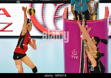 (180427) -- ISTANBUL, April 27, 2018(Xinhua) -- Vakifbank player Zhu Ting(L) spikes the ball during the fifth leg match of the 2017-2018 Turkish Women Volleyball League final series between Vakifbank and Eczacibasi in Istanbul, Turkey, on April 26, 2018. Vakifbank won the match 3-0 and claimed the champion with 3-2 in total.(Xinhua/He Canling) - Stock Photo