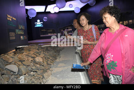 Haikou, China's Hainan Province. 26th Apr, 2018. Tourists view cultural relics at China Nanhai (South China Sea) Museum at Tanmen Township in Qionghai City, south China's Hainan Province, April 26, 2018. The museum opened here Thursday. Credit: Zhao Yingquan/Xinhua/Alamy Live News - Stock Photo