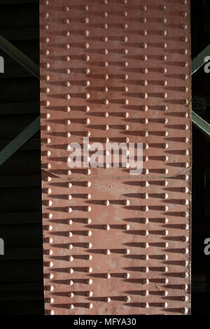 Girder and rivets on underside of railway bridge over the River Clyde, Glasgow - Stock Photo