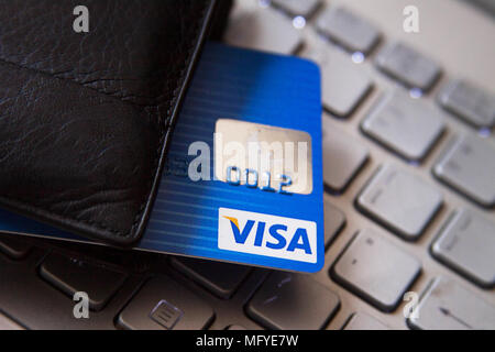 Macro of four credit card on a computer keyboard. Electronic online payment - Stock Photo