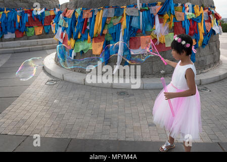 happy asian kid playing soap bubble ,candid Stock Photo ...