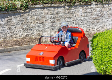 Young boy driving car at Lego City Driving School, Legoland Windsor Resort, Windsor, Berkshire, England, United Kingdom - Stock Photo