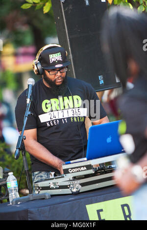 A deejay uses sophisticated electronics to enhance the audio and play rap music at Atlanta Hip Hop Day, on October 8, 2016 in Atlanta, GA. - Stock Photo