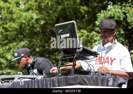 Two deejays use sophisticated electronics to enhance the audio and support the performers at Atlanta Hip Hop Day on October 8, 2016 in Atlanta, GA. - Stock Photo