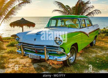 Trinidad, Cuba, Nov 28, 2017 - Green and white 1950's Class America  Ford Fairlane parked on beach - Stock Photo