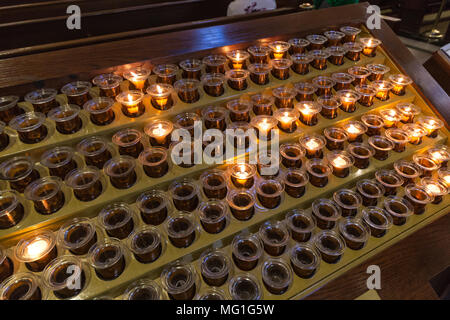 Prayer Candles in a church - Stock Photo