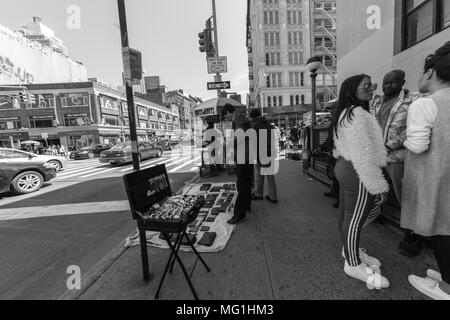Street shot of people selling purses and watches, NYC Manhattan - Stock Photo