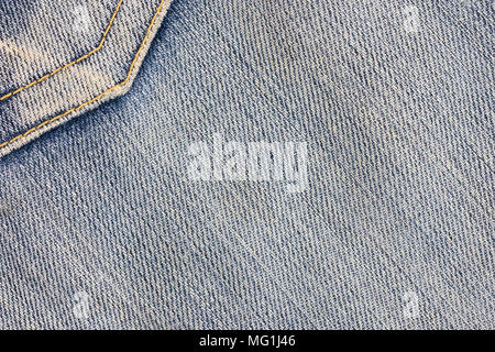 Abstract background and texture of jean. Denim pocket sewn with yellow thread. Stains on jeans - Stock Photo