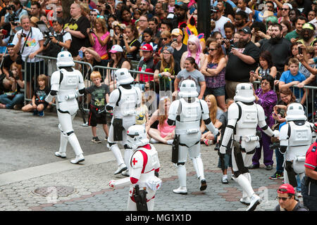 People dressed as storm troopers from the Star Wars movies interact with fans and walk in the Dragon Con Parade on September 3, 2016 in Atlanta, GA. - Stock Photo