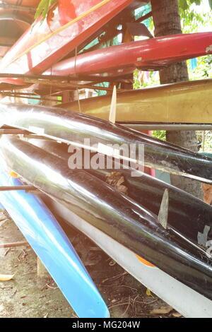 Boats on Racks with Light Leak. - Stock Photo