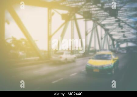 Blurred Taxi on Memorial Bridge, Bangkok Thailand. - Stock Photo