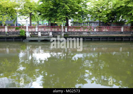 Scenery of Phasi Charoen Canal with Green Trees on The Bank, Bangkok Thailand. - Stock Photo