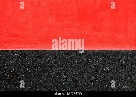 Red and Black Two Tone Concrete Wall with Top Space for Text. - Stock Photo