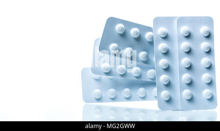 Colchicine 0.6 mg tablets pills in light resistant packaging isolated on white background. Gout attack, gout pain and gouty arthritis concept. Pharmac - Stock Photo