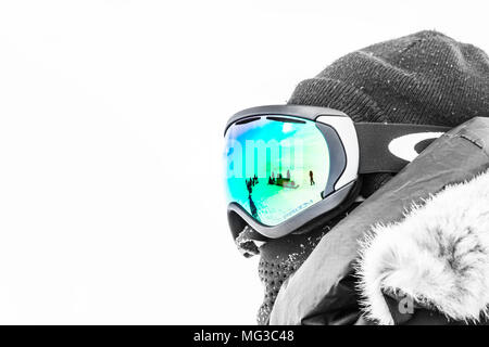 Unrecognisable but intrepid polar explorer with skidoo's reflected in the goggles.  Baffin Island, Canada, Arctic, Nunavut - Stock Photo