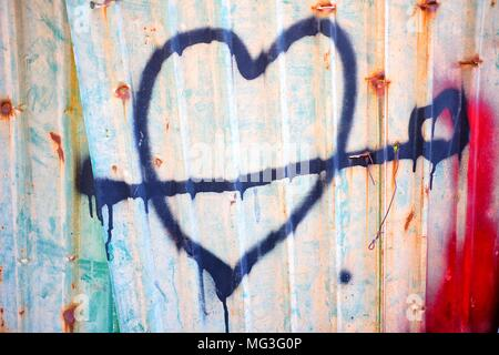 Spray Painted Heart Sing on Old Zinc Wall. - Stock Photo