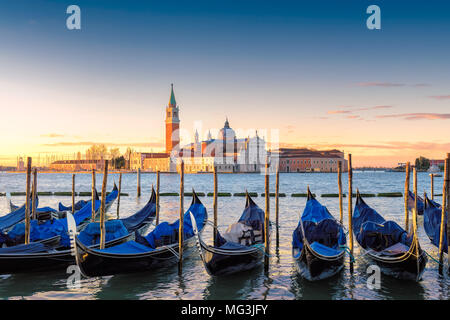 Venetian gondolas at sunrise, Venice, Italy. - Stock Photo