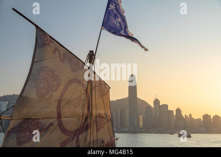Junk boat in Victoria Harbour, Hong Kong Island, Hong Kong - Stock Photo