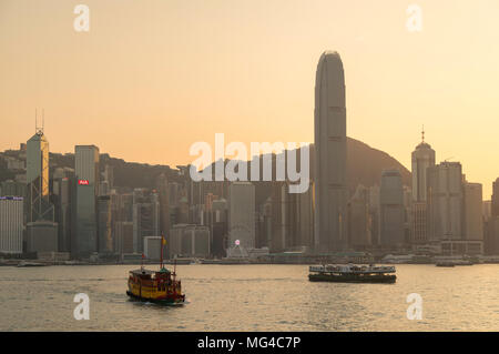 Star Ferry in Victoria Harbour at sunset, Hong Kong Island, Hong Kong - Stock Photo