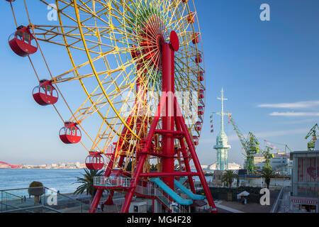 Ferris wheel at harbour, Kobe, Kansai, Japan - Stock Photo