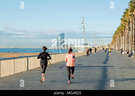 Running jogging on Barcelona Beach, Barceloneta. Healthy lifestyle people runners training outside on boardwalk. Multiracial couple, Asian woma fitnes - Stock Photo