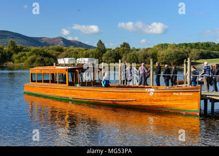 Tourists boarding the Lady Derwentwater motor launch at Keswick landing stage on Derwent Water in the Lake District National Park, Cumbria, England - Stock Photo