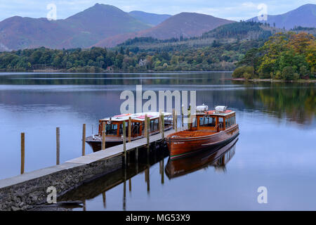 Lady Derwentwater and Princes Margaret Rose cruisers at Keswick landing stage at dawn on Derwent Water Lake District National Park, Cumbria, England - Stock Photo