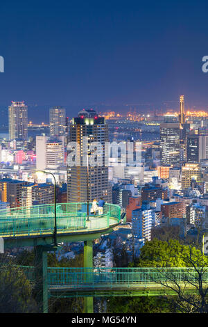 View of Kobe skyline at dusk, Kobe, Kansai, Japan - Stock Photo