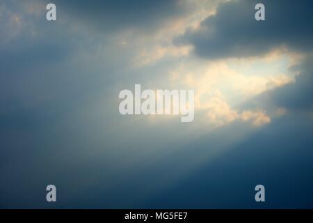 Sunlight through Clouds. - Stock Photo