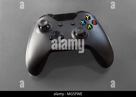 Handheld computer gamepad for young gamers playing virtual video games for fun. - Stock Photo
