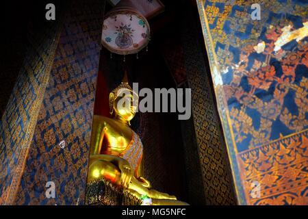 Ancient Golden Buddha image in main hall at Wat Intharam Temple Bangkok Thailand. - Stock Photo