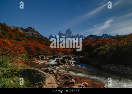 View of the Fitz Roy mountain and the waterfall in the Los Glyacious National Park. Autumn in Patagonia, the Argentine side - Stock Photo