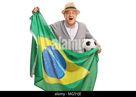 Excited elderly soccer fan holding a football and a Brazilian flag isolated on white background - Stock Photo
