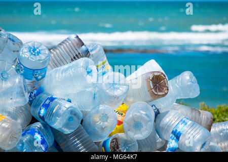 Plastic bottles and other rubbish / pollution on a beach in Morocco with sea in distance - Stock Photo