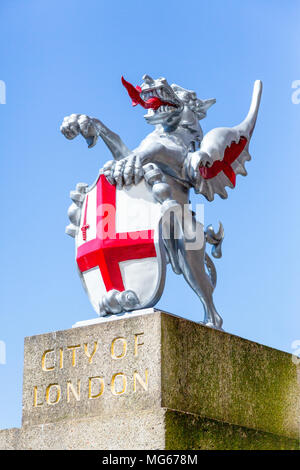 London, United Kingdom - April 23, 2015: A sunny spring day and the dragon greets visitors to the official City of London, shining in silver. - Stock Photo
